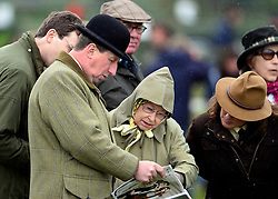 © Licensed to London News Pictures. 10/05/2013. Windsor, UK  HRH Queen Elizabeth II looks at a programme whilst she watches horses in the show. The Royal Windsor Horse Show, set in the grounds of Windsor Castle. Established in 1943, this year will see the Show celebrate its 70th anniversary. Photo credit : Stephen Simpson/LNP