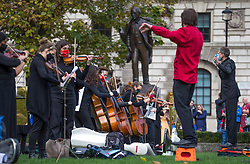 © Licensed to London News Pictures. 26/10/2020. London, UK. Dancers and classical musicians from the group 'We Make Events' perform Swan Lake in Parliament Square in central London in a call for more support for freelancers in the entertainment industry. Photo credit: Marcin Nowak/LNP