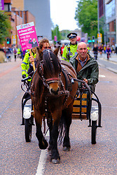 © Licensed to London News Pictures. 03/10/2021 Manchester, UK. Travellers lead Protest The Tory Party, against the Crime and policing bill, organised by People's Assembly Against Austerity outside Conservative Party Conference. Photo credit: Jess Hurd/LNP
