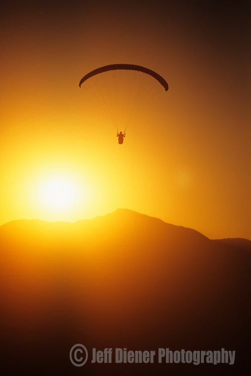A paraglider soars at the Point of the Mountain in Salt Lake City, Utah.