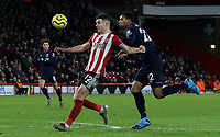 Sheffield United's John Egan shields the ball from West Ham United's Sebastien Haller <br /> <br /> Photographer Rich Linley/CameraSport<br /> <br /> The Premier League - Sheffield United v West Ham United - Friday 10th January 2020 - Bramall Lane - Sheffield <br /> <br /> World Copyright © 2020 CameraSport. All rights reserved. 43 Linden Ave. Countesthorpe. Leicester. England. LE8 5PG - Tel: +44 (0) 116 277 4147 - admin@camerasport.com - www.camerasport.com