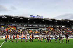 The Saracens players leave their new pitch after a warmup before the first half of the match - Photo mandatory by-line: Rogan Thomson/JMP - Tel: Mobile: 07966 386802 16/02/2013 - SPORT - RUGBY - Allianz Park - Barnet. Saracens v Exeter Chiefs - Aviva Premiership. This is the first Premiership match at Saracens new home ground, Allianz Park, and the first time Premiership Rugby has been played on an artificial turf pitch.