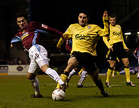 Fotball<br /> England 2004/22005<br /> Foto: SBI/Digitalsport<br /> NORWAY ONLY<br /> <br /> Burnley v Liverpool<br /> FA Cup 3rd Round, 18/01/2005.<br /> <br /> Burnley's Jean Louis Valois (L) sticks out a leg to dispossess Liverpool's Antonio Nunez