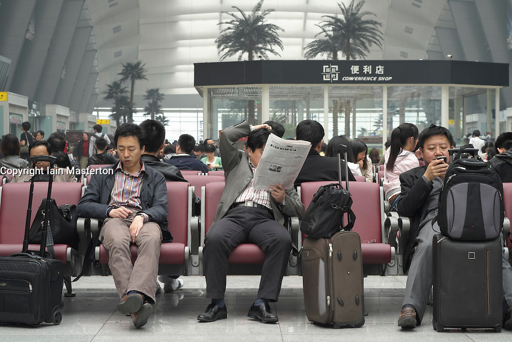 Passengers waiting in new modern Beijing South Railway Station in China