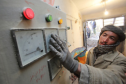 M. Sarwar Is the operator, checking the gauges on the micro hydro generator as it produces electricity for the village.  The system can be alternated into a grain mill when required.  NCA supported the construction of this system. Dara-e-Foladi Village,, Bamyan Province, Afghanistan
