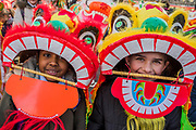 Children from the Medway River School - Chinese New Year Celebrations in London 2018 marking the arrival of the Year of the Dog. The Event started with a Grand Parade from the North East side of the Trafalgar Square and finishing in Chinatown at Shaftesbury Avenue. It was organised by London Chinatown Chinese Association and is supported by The Mayor of London and Westminster City Council.