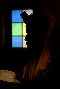 Silhouette of a Jewish man in prayer with tallith and Tefillin
