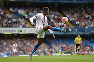 Wilfried Zaha of Crystal Palace controlling the ball mid air. Barclays Premier League, Chelsea v Crystal Palace at Stamford Bridge in London on Saturday 29th August 2015.<br /> pic by John Patrick Fletcher, Andrew Orchard sports photography.