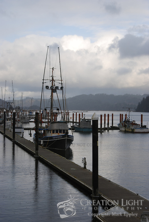 Fishing boat dock in the harbor in Florence, Oregon.  Fishing is an important activity along the coast of Oregon.