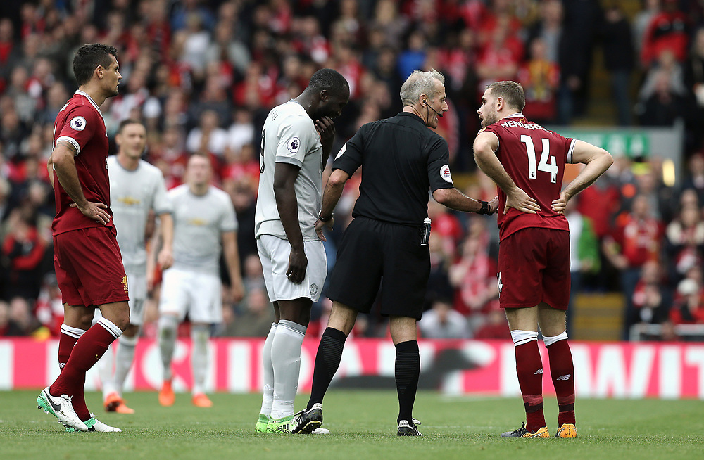 Liverpool's Jordan Henderson protests to referee Martin Atkinson as he has words with Manchester United's Romelu Lukaku following his foul on Liverpool's Joe Gomez<br /> <br /> Photographer Rich Linley/CameraSport<br /> <br /> The Premier League - Liverpool v Manchester United - Saturday 14th October 2017 - Anfield - Liverpool<br /> <br /> World Copyright © 2017 CameraSport. All rights reserved. 43 Linden Ave. Countesthorpe. Leicester. England. LE8 5PG - Tel: +44 (0) 116 277 4147 - admin@camerasport.com - www.camerasport.com