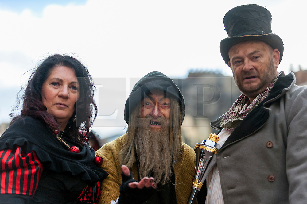 © Licensed to London News Pictures. 03/12/2016. Rochester, UK. People dressed as (L to R) Nancy, Fagin and Bill Sykes from Oliver Twist as participants take part in the Rochester Dickensian Christmas Festival.  The Kent town is given a Victorian makeover to celebrate the life of the writer Charles Dickens (who spent much of his life there), with Victorian themed street entertainment, costumed parades and a Christmas market. Photo credit : Stephen Chung/LNP