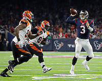 Houston Texans quarterback Tom Savage (3) throws an incomplete pass as Cincinnati Bengals defensive end Michael Johnson (90) and defensive tackle Geno Atkins (97) defend during the second half of an NFL football game Saturday, Dec. 24, 2016, in Houston. (AP Photo/Sam Craft)