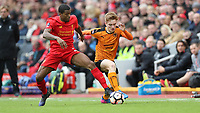 Football - 2016 / 2017 FA Cup - Fourth Round: Liverpool vs. Wolverhampton Wanderers<br /> <br /> Georginio Wijnaldum of Liverpool and Connor Ronan of Wolverhampton Wanderers  during the match at Anfield.<br /> <br /> COLORSPORT/LYNNE CAMERON