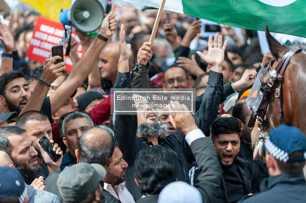 Demonstrators gathered outside India House in London to show support for Kashmiris and to protest against occupation and oppression by India in Kashmir.<br /> <br /> Police worked to keep the protesters and counter protesters apart through use of barriers, mounted police and lines of police.<br /> <br /> Richard Hancox | EEm 15082019