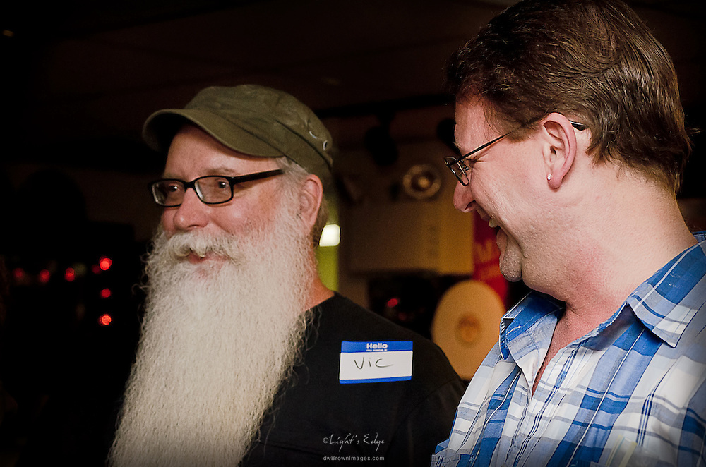 Vic Martinson, owner of The Bus Stop Music Cafe, and Dave Heine, Sarah's dad, chat it up during the Birthday Party.