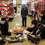 3/14/12 -- BATH, Maine.  Firemen at Bath Firehouse worked with staffers from Maine EMS today at the Human Patient Simulator Lab, an RV refitted to bring in responsive mannequins designed to react to health care workers' treatments. Photo by Roger S. Duncan.