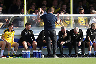 Oxford United manager Karl Robinson with hands in the air during the EFL Sky Bet League 1 match between AFC Wimbledon and Oxford United at the Cherry Red Records Stadium, Kingston, England on 29 September 2018.