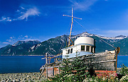 """Alaska, Haines. Wrecked fishing boat """"Partner"""" on the shores of Chilkoot Inlet on the upper arm of Lynn Canal."""