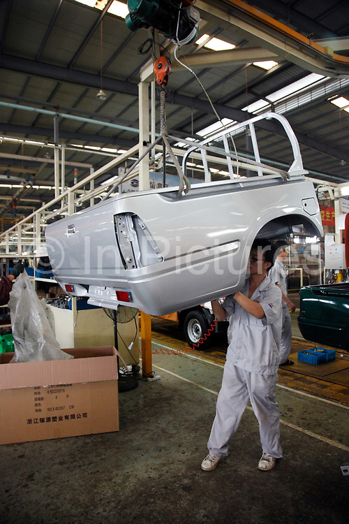 Workers assemble pick up trucks at the GoNow, a subsidiary of Guanzhou Auto Corporation, in Taizhou, Zhejiang Province, China, on 31 August, 2010.  Many domestic car makers have sprung up around the country in hopes of cashing in China's booming automobile market.