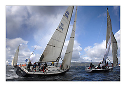 Sailing - The 2007 Bell Lawrie Scottish Series hosted by the Clyde Cruising Club, Tarbert, Loch Fyne..Brilliant first days conditions for racing across the three fleets..Class 1 GBR9641R Local Hero rounds the Leeward mark with Team Kingspan having difficulties..