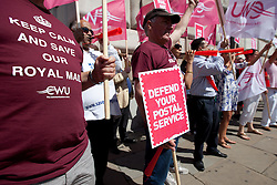 © Licensed to London News Pictures. 10/07/2013. London, UK. Postal workers and campaigners from the Communication Workers Union protest outside the Royal Mail headquarters against privatisation of Royal Mail in London today (10/07/2013). Photo credit: Matt Cetti-Roberts/LNP