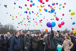 © Licensed to London News Pictures. 16/01/2017. York UK.Picture shows Katie Rough's parents Paul Rough & Alison Rough (centre) , the couple where joined by hundreds of people in Westfield Park in York this afternoon to release balloons on what would have been Katie's 8th birthday. Katie died last week after being found with significant cuts to her neck & chest.  Photo credit: Andrew McCaren/LNP