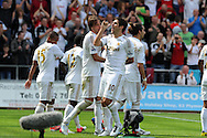 Swansea city's Danny Graham (10) celebrates after he scores his sides 3rd goal. . Barclays Premier league, Swansea city  v West Ham Utd at the Liberty Stadium in Swansea, South Wales  on Saturday 25th August 2012. pic by Andrew Orchard, Andrew Orchard sports photography,