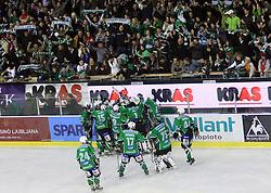 Olimpija and it's fans celebrate at 39th Round of EBEL League ice hockey match between HDD Tilia Olimpija and Acroni Jesenice, on December 30, 2008, in Arena Tivoli, Ljubljana, Slovenia. Tilia Olimpija won 4:3. (Photo by Vid Ponikvar / SportIda).