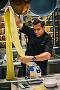 Chef Todd English preparing raviolis at Todd English Food Hall at the Plaza Hotel in New York City