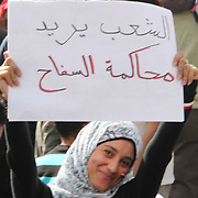 A demonstrating woman in Cairo's Tahrir Square calls for ex-president Hosni Mubarak to be put on trial.