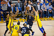 Golden State Warriors guard Stephen Curry (30) attempts to block a shot by Minnesota Timberwolves guard Jeff Teague (0) at Oracle Arena in Oakland, Calif., on January 25, 2018. (Stan Olszewski/Special to S.F. Examiner)