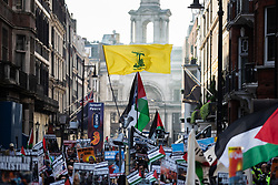 © Licensed to London News Pictures. 10/06/2018. London, UK. A Hezbollah flag is flown during the annual Al Quds day march in support of the Palestinian cause, in central London. Photo credit: Joel Goodman/LNP