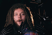 Virtual reality: Jaron Lanier, head of VPL Research of Redwood City, California. Fiber- optic sensors in the black rubber glove Lanier is wearing transmit a user's movements into the computer-generated virtual environment. A user's view of such a world is projected by the computer into 2 eye phones mounted on a headset. Model Released (1990)