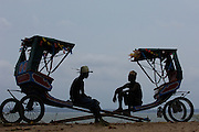 Local rickshaws (Pousse-pousses) introduced to Madagascar by the British missionaries. Majunga Town. NW MADAGASCAR  2005