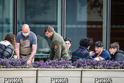 Following the government decision to reopen Britain, the picture shows people eating outdoors in the city of Manchester on Wednesday, April 28, 2021. Manchester is part of the UK to lift some of the restrictions designed to stop the spread of Covid-19. (Photo/ Vudi Xhymshiti)