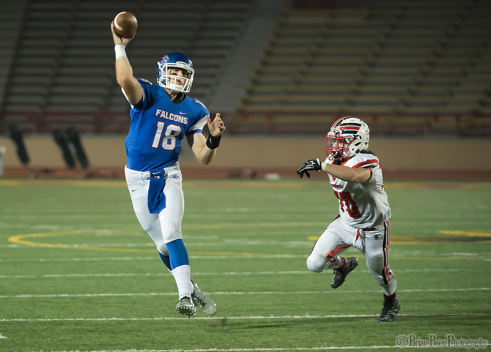 Christian Brothers Falcons Tyler Vander Waal (18), passes the ball during the second quarter of the Sac-Joaquin Section Division I football playoff game between the Christian Brothers Falcons and Cordova Lancers at Hughes Stadium,  Friday Nov 11, 2016.<br /> photo by Brian Baer