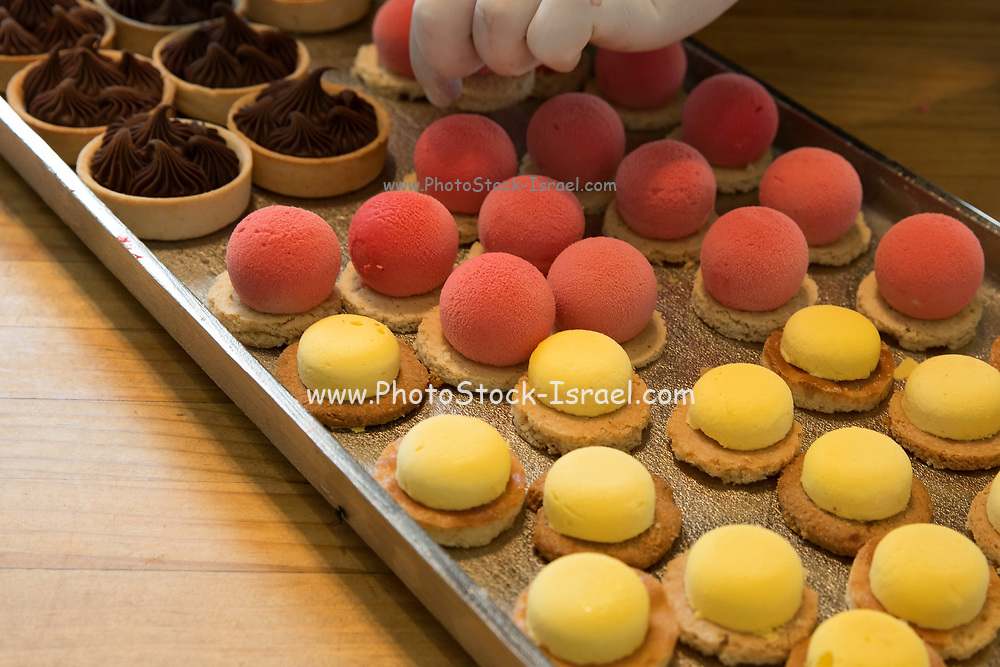 Puffs. Balls of strawberry and lemon flavoured mousse on a biscuit base