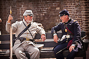 A Union Civil War re-enactor talks with a Confederate soldier on the 150th anniversary of the surrender of Fort Sumter on April 14, 2011 in Charleston, South Carolina.  A historic re-enactment of the surrender took place at the fort to mark the end of a week long commemoration of the start of the US Civil War.
