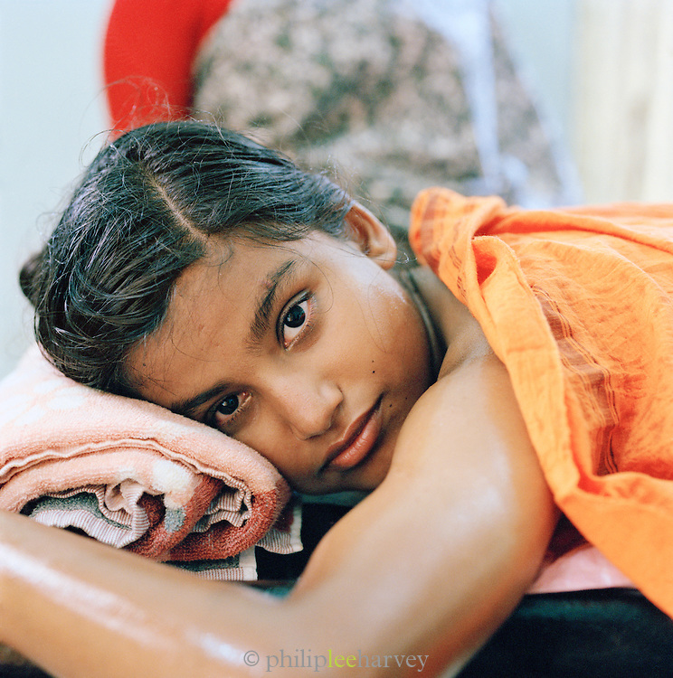 Portrait of a young girl about to receive ayurvedic treatment .Kerala, India.
