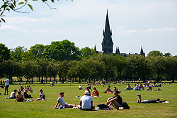 Edinburgh, Scotland, UK. 29 May 2020. Sunshine and temperatures of 23C in Edinburgh city centre. The Meadows park busy with public taking advantage of new relaxed Covid-19 rules that allow sunbathing.  Iain Masterton/Alamy Live News