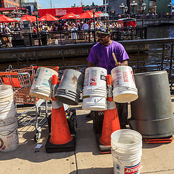 Baltimore, MD, USA - June 16, 2012: A makeshift trash can drummer at Inner Harbor in the City of Baltimore, Maryland.