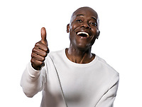 Portrait of a very happy afro American showing thumbs up in studio on white isolated background