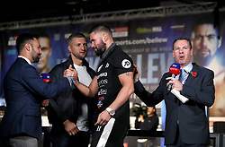 Tony Bellew (centre) with Paul Malignaggi (left) and Carl Froch (second left) after an interview with Sky Sports during the weigh in at Manchester Central.