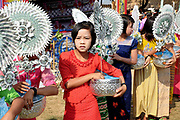 Shinbyu Novice Ceremony on 21st March 2016 in Mo Bye village, Shan State, Myanmar. In Myanmar, it is customary for boys to enter the monastery as a Buddhist novice between the age of ten and 20 years old although they can be as young as four, for at least one week. During the ceremony, which lasts two or sometimes three days, the boys dressed as princes are led on horseback through the village. Joining the procession are the boys' families, the parents carrying the monastic robes for the novices and the sisters or young village girls carrying flowers and ceremonial boxes.
