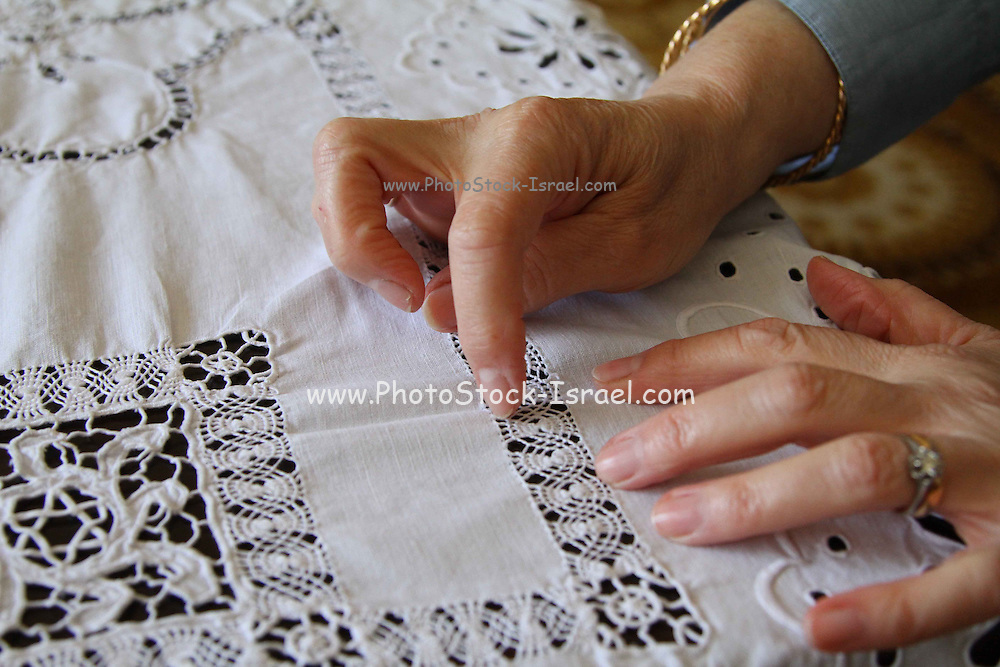 A hand Embroidered tablecloth from the previous century made in Tripoli, Libya, A Jewish Star of David is hidden in the center..