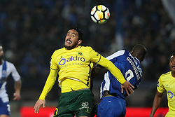 March 11, 2018 - Pacos Ferreira, Pacos Ferreira, Portugal - Porto's Cameroonian forward Vincent Aboubakar (R) vies with Pacos Ferreira's Portuguese defender Joao Gois (L) during the Premier League 2017/18 match between Pacos Ferreira and FC Porto, at Mata Real Stadium in Pacos de Ferreira on March 11, 2018. (Credit Image: © Dpi/NurPhoto via ZUMA Press)
