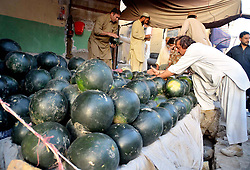 June 1, 2017 - Pakistan - QUETTA, PAKISTAN, JUN 01: Water melons are being selling at a roadside stall as the .demand of water melon increases during Ramadan-ul-Mubarak in Quetta on Thursday, June 01, .2017. (Credit Image: © PPI via ZUMA Wire)