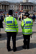 Two Police officers patrol in Trafalgar Square at a large event. The MPS, Metropolitan Police Service, is the territorial police force responsible for policing Greater London, excluding the 'square mile' of the City of London which is the responsibility of the City of London Police.