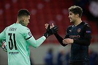 PIRAEUS, GREECE - NOVEMBER 25: Ederson of Manchester City and John Stones of Manchester City during the UEFA Champions League Group C stage match between Olympiacos FC and Manchester City at Karaiskakis Stadium on November 25, 2020 in Piraeus, Greece. (Photo by MB Media)