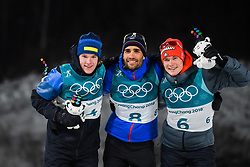 February 12, 2018 - Pyeongchang, SOUTH KOREA - 180212  Sebastian Samuelsson of Sweden, Silver, Martin Fourcae of France, Gold,  and Benedikt Doll of Germany, Bronze, celebrates on the podium after in the Men's Biathlon 12,5km Pursuit during day three of the 2018 Winter Olympics on February 12, 2018 in Pyeongchang..Photo: Jon Olav Nesvold / BILDBYRÃ…N / kod JE / 160157 (Credit Image: © Jon Olav Nesvold/Bildbyran via ZUMA Press)